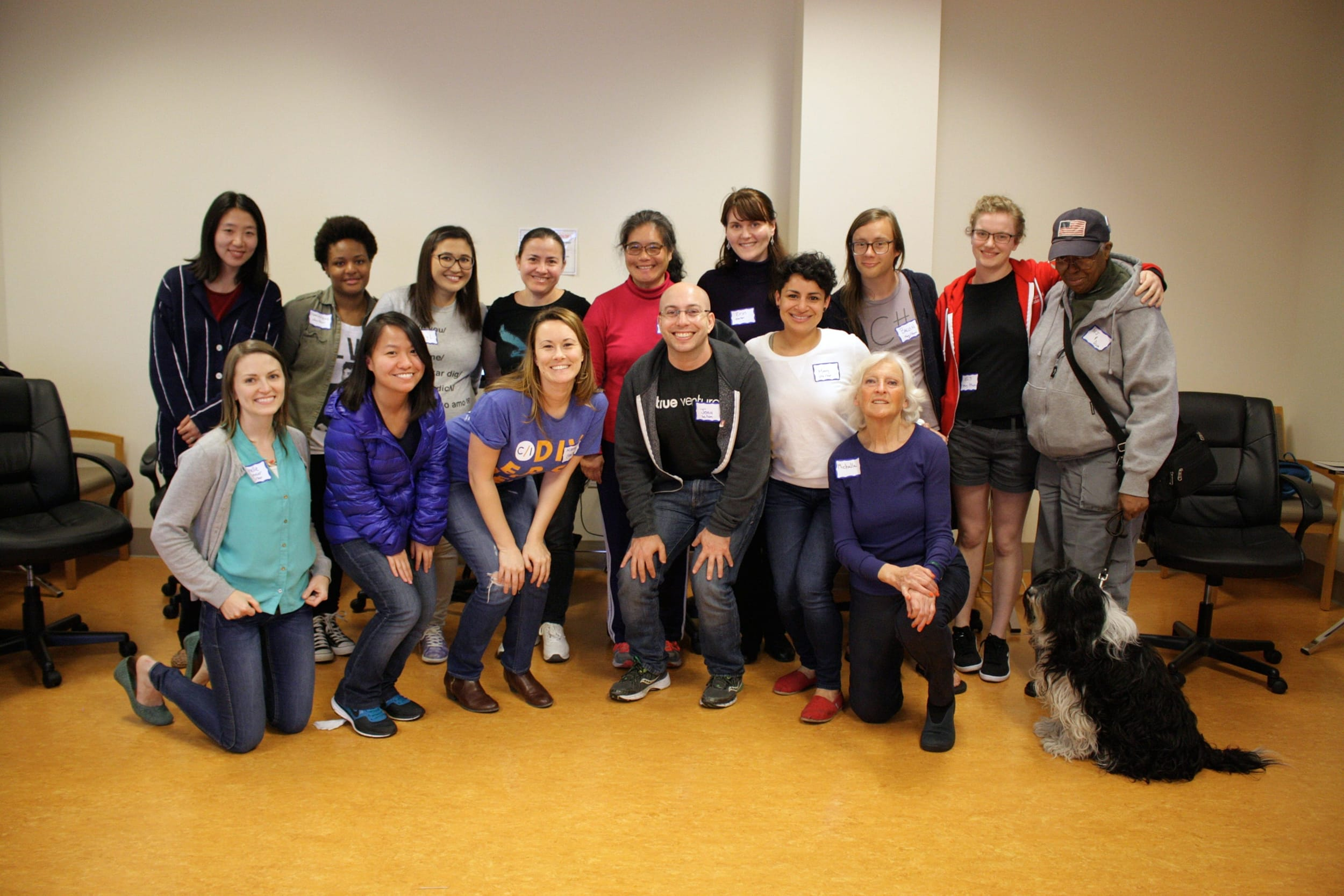 Fifteen participants, mostly women, gathered after a workshop.